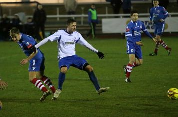Needham's Callum Harrison (L) and Enfield's Billy Crook