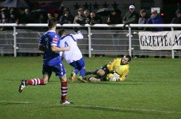 Needham keeper Danny Gay saves from Scott Shulton