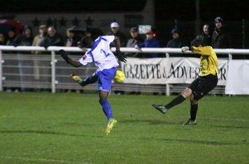Needham keeper Danny Gay just misses Percy Kiangebeni with a clearance