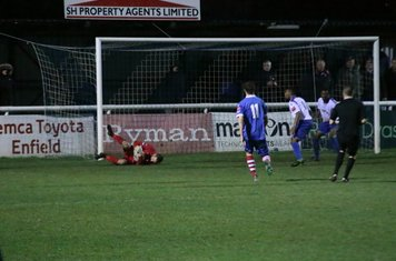 Enfield keeper NathanMcDonald cuts out a cross at his near post