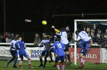 Needham keeper Danny Gay punches clear