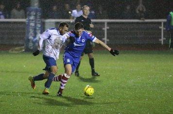 Needham's John Sands (R) holds off Scott Shulton