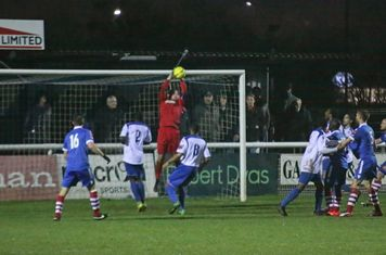 Enfield keeper Nathan McDonald catches a late cross