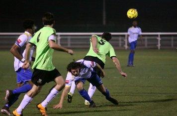 Hendon's Luke Tingey (R) challenges Harry Ottaway