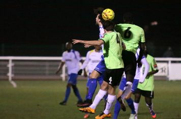 Enfield's Harry ottaway challenges by Casey Maclaren (4) and  Dave Diedhiou