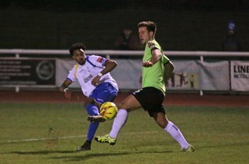 Enfield's Dernell Wynter curls a shot from the edge of the area