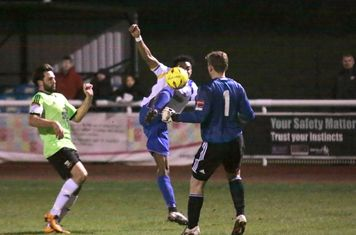 Enfield's Dernell Wynter tries to lift the ball over keeper Tom Lovelock