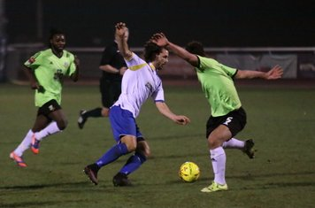 Enfield's Harry Ottaway takes the ball past Luke Tingey (R)