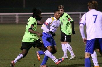 Hendon's Laste Dombaxe (L) challenges Jonathan Muleba