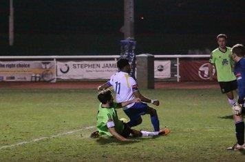 Hendon's Casey Maclaren (L) blocks Dernell Wynter's shot