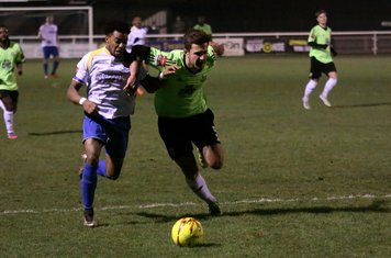 Enfield's Dernell Wynter (L) and Hendon's Luke Tingey challenge for possession