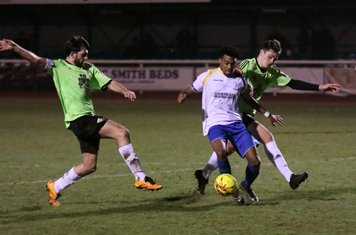 Enfield's Dernell Wynter tries to line up a shot under pressure from Casey Maclaren (L) and Jamie Smith