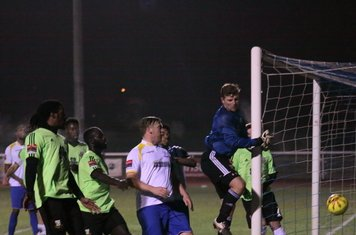 Hendon keeper Tom Lovelock covers his near post as  a corner is hit straight into the side netting