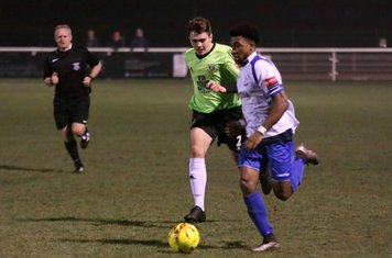 Hendon's Jamie Smith (green() chases Dernell Wynter