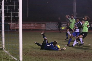 Hendon's Tom Lovelock saves Harry Ottaway's shot and makes sure Dernell Wynter can't reach the loose ball