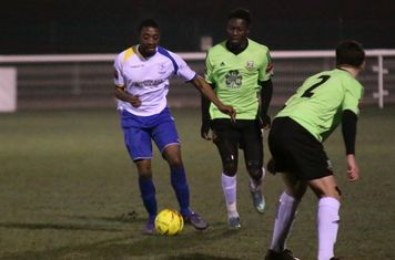 Enfield's Ricky Gabriel and Hendon's Marcel Barrington and Jamie Smith (R)