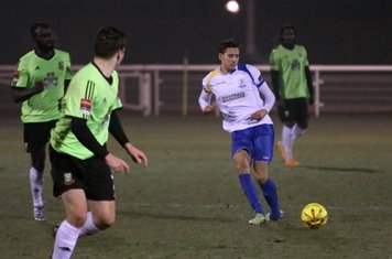 Enfield's Tom Collins passes to the left wing