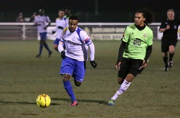 Enfield's Bobby Devyne (L) and Hendon's Kezie Ibe