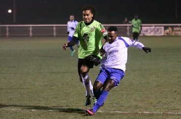 Enfield's Bobby Devyne (R) holds off Kezie Ibe but shoots wide