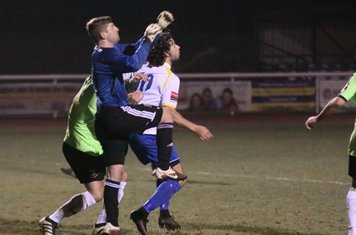 Hendon keeper Tome Lovelock comes out to collect under pressure from Harry Ottaway