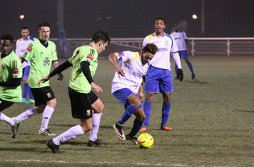 Enfield's Tyler Campbell (white) challenged by Jamie Smith