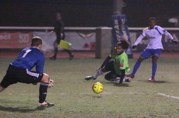 Hendon keeper Tom Lovelock saves from Bobby Devyne