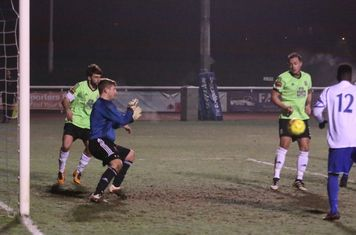Hendon keeper Tom Lovelock sets himself to block a late shot