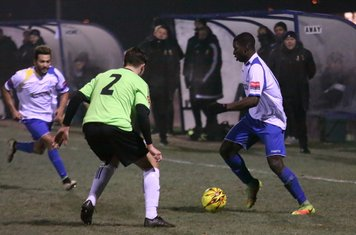 Enfield's Percy Kiangebeni (R) and Tyler Campbell and Hendon's Jamie Smith