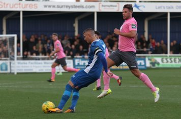 Billericay's Paul Konchesky clears from Adam Martin