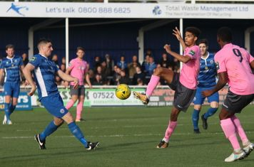 Enfield's Montell Moore and Ryan Blake (9) and Billericay's Danny Waldren
