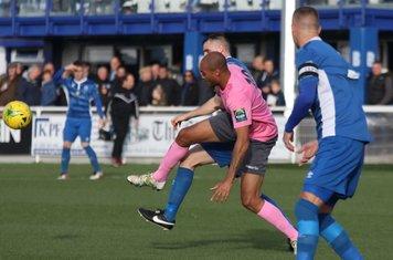 Enfield's Simon Thomas (pink) challenges Danny Waldren
