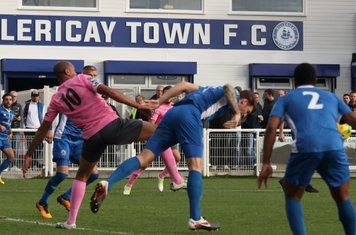 Billericay's Rob Swaine (blue) heads clear from Simon Thomas