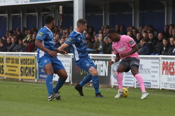 Enfield's Ryan Blake and Billericay's Leo Chambers (L) and Danny Waldren