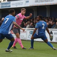 Billericay's Jermaine Pennant (L) and Leo Chambers and Enfield's  Dan Rumens