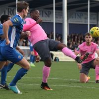 Enfield's Rob Bartley (pink, centre)