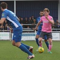 Enfield's Aaron Greene (pink) breaks clear of Jermaine Pennant