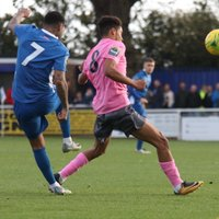 Billericay's Jermaine Pennant (7) hits a clearance against Montell Moore