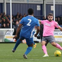 Billericay's Leo Chambers (2) tries to block a shot from John Kyriacou