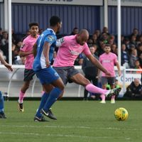Enfield's Simon Thomas (pink, R) plays the ball wide