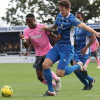 Billericay's Rob Swaine brings down Ryan Blake (pink) to concede a penalty