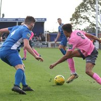 Enfield's Montell Moore (R) and Billericay's Rob Evans