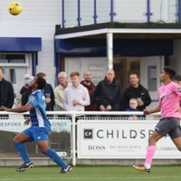 Billericay's Leo Chambers (L) and Enfield's Montell Moore