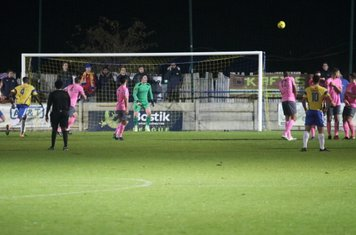 Enfield's keeper Joe Wright seems unconcerned as a free kick curls wide of the post