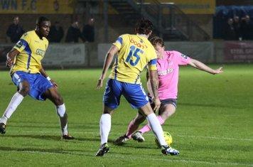 Aaron Greene (pink) beats Greg Haydon before scoring the second Enfield goal