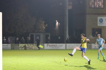 Staines' Ben Martin gets back in time to clear a lob from Drew Roberts
