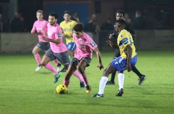 Enfield's Montell Moore (pink, R) and Staines' Wadah Ahmidi