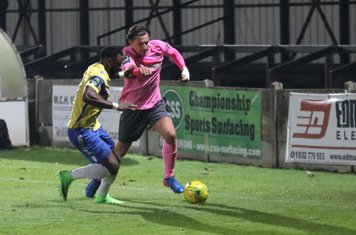 Staines' Tyrell Miller-Rodney (L) and Enfield's Sam Youngs