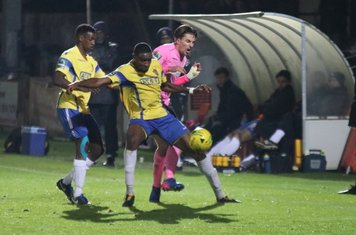 Staines' Wadah Ahmidi (L) and Bayley Brown and Enfield's Sam Youngs