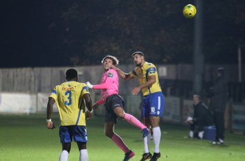 Staines' Tyrell Miller-Rodney (L) and Mo Bettamer and Enfield's Sam Youngs