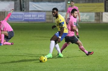 Staines' Tyrell Miller-Rodney (yellow) and Enfield's Drew Roberts